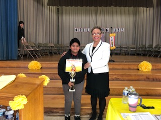 Superintendent Serves as Announcer at Easton Spelling Bee
