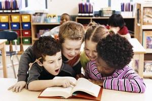 students reading a book together in class: 3-5 Resources