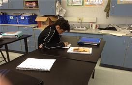 A student works on his rough draft letter