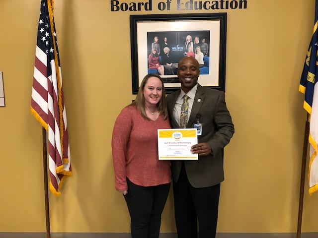 Principal Mr. Jordan and School Improvement Team Chairperson Kelly Poteet receive recognition for Hall-Woodward meeting expected