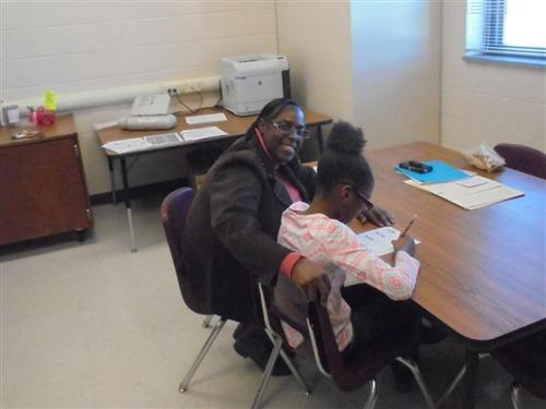 Ms. Ingram-Jackson working one-on-one with a fourth grader.