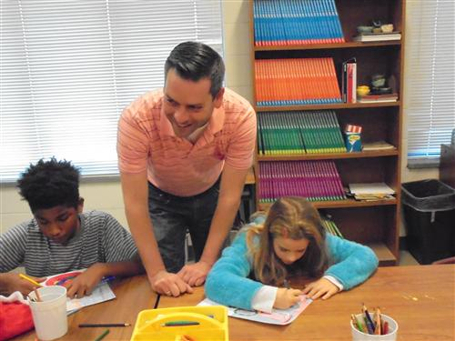 Mr. Raines working with some of our 5th graders.