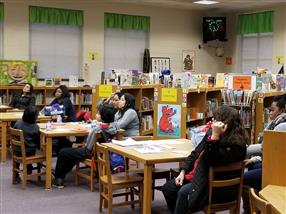 Parents at the evening session of the Literacy Information Meeting