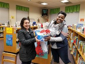 Another parent door prize winner at the Literacy Informational Meeting