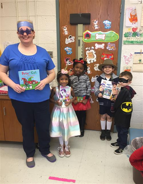 Ms Ford and four students dressed as book characters