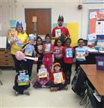 Mrs Nuckolls and Mr Davis with nine students as book characters
