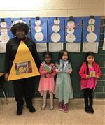 Mrs Purvis with three students as book characters