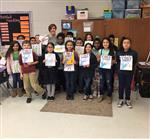 Ms Boltin and sixteen students as book characters