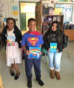 Three students as book characters