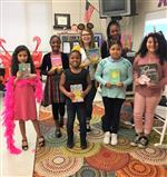 Ms Boone and six students as book characters