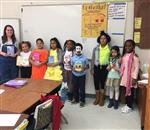 Ms Robertson and eight students as book characters