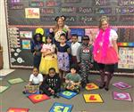 Ms Robinson and Ms Hanreck with eight students as book characters