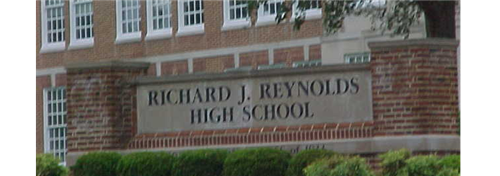 sign in front of school