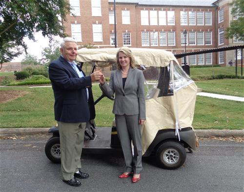 Harry Corpening & Leslie Alexander and the RJR golf cart