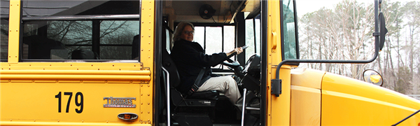 Bus driver sitting at the wheel of a school bus