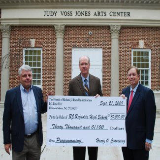 Harry Corpening & Jim Jolmes, III giveing $30,000 check to Art Paschal